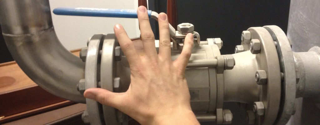 hand reaching for an open valve